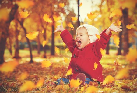 Photo for Happy little child, baby girl laughing and playing in the autumn on the nature walk outdoors - Royalty Free Image