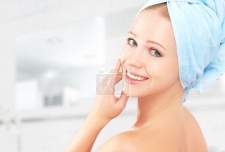 Photo for Skin care. young beautiful healthy girl in a towel in the bathroom - Royalty Free Image