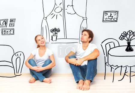Concept : happy couple in  new apartment dream and plan interior