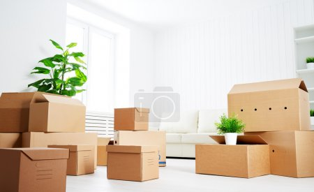 Photo for Move. lots of cardboard boxes in an empty new apartment - Royalty Free Image