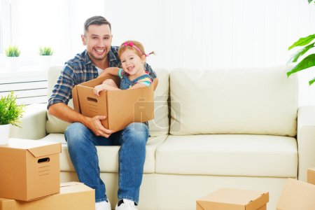 happy family moves to new apartment. dad and child  daughter wit