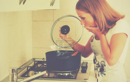 funny woman housewife prepares in the kitchen