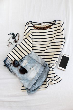 Photo for Striped shirt with cropped jeans and various accessories - Royalty Free Image