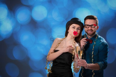 Photo for Young couple with champagne flutes celebrating New year's eve and having fun - Royalty Free Image