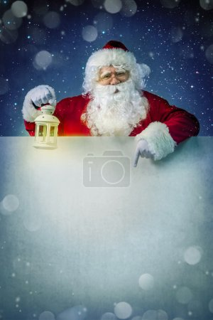 Photo for Santa Claus with lantern on billboard - Royalty Free Image