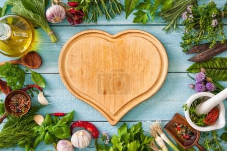 Photo for Fresh kitchen herbs and spices on wooden table. Top view - Royalty Free Image
