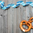 Bavarian pretzels with ribbon on wooden board as a...