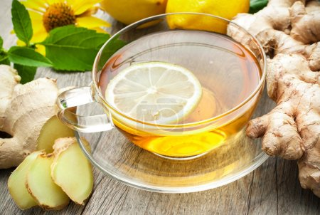 Photo for Cup of ginger tea with lemon on wooden table - Royalty Free Image