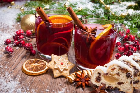 Photo for Two glasses of  mulled wine with christmas decoration - Royalty Free Image