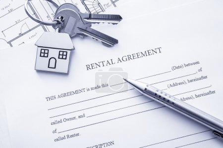 Photo for Rental agreement document with keys and pencil - Royalty Free Image