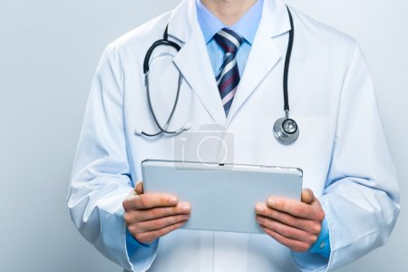 Doctor using a digital tablet