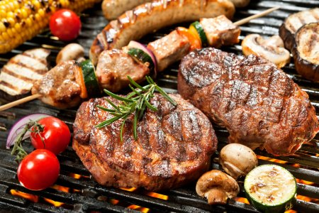 Photo for Assorted delicious grilled meat with vegetable over the coals on a barbecue - Royalty Free Image