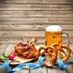 Roasted pork knuckle with pretzels and beer. Oktob...