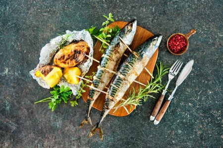 Grilled mackerel fish with baked potatoes