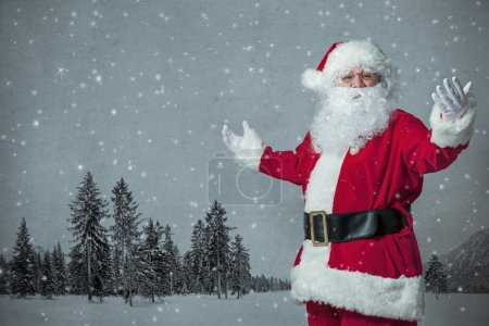 Photo for Santa Claus welcomes with spread arms - Royalty Free Image