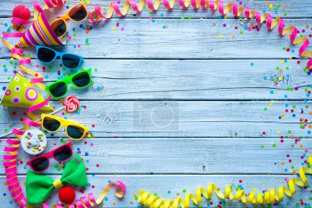 Photo for Colorful carnival background with party accessory, streamers and confetti - Royalty Free Image
