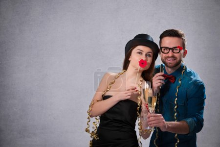 Young couple with champagne flutes