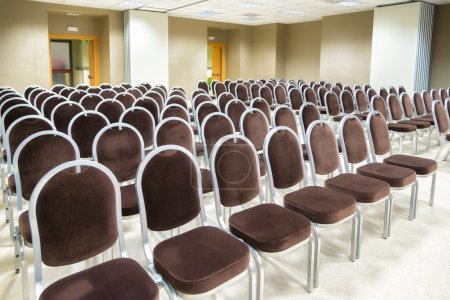row of chairs in empty presentation room
