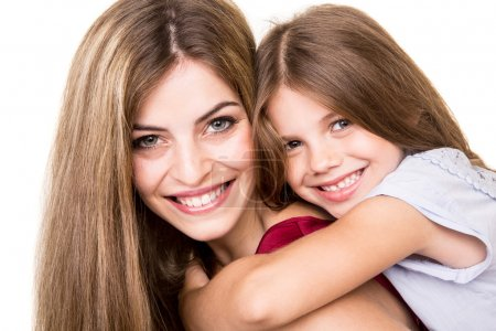 Photo for Beautiful portrait of hugging mother and daughter - Royalty Free Image