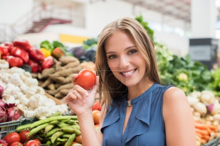 Photo for Blonde woman shopping organic veggies and fruits - Royalty Free Image