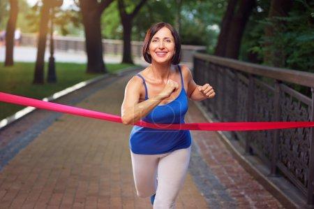 Woman crosses finish line