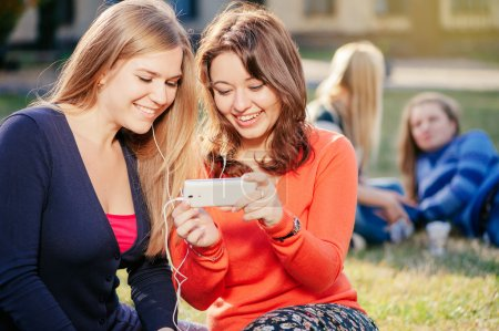 Two women with smart phone