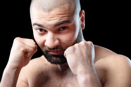 man keeping fists