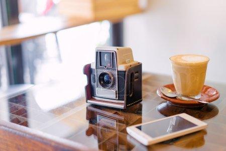 Smartphone, coffee and camera