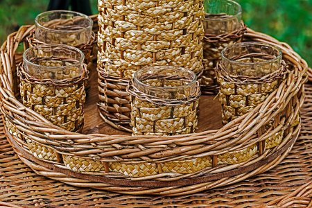 Glasses and bottle wrapped in wicker