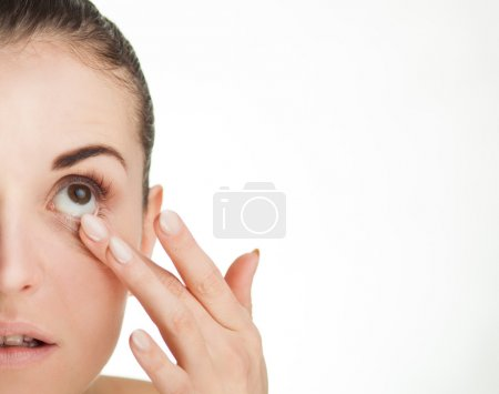 Woman touching her eye concept of healthcare