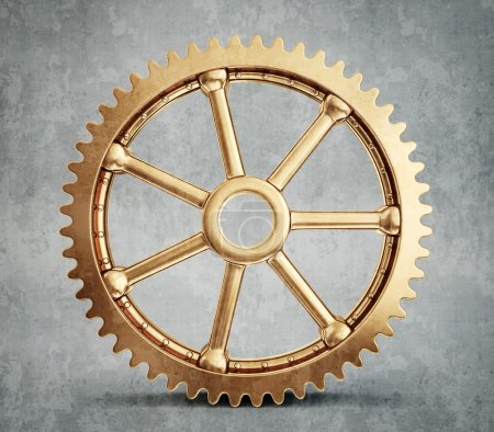 Gold gear isolated on grey