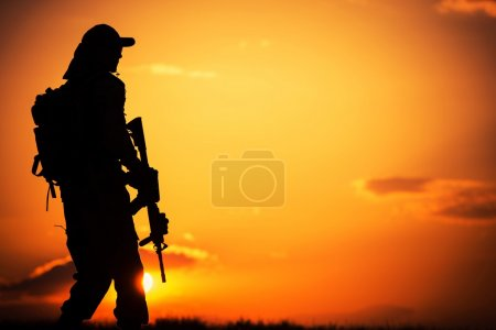 Photo for Call of Duty. Military Concept with Soldier with Assault Rifle on Duty During Sunset. - Royalty Free Image
