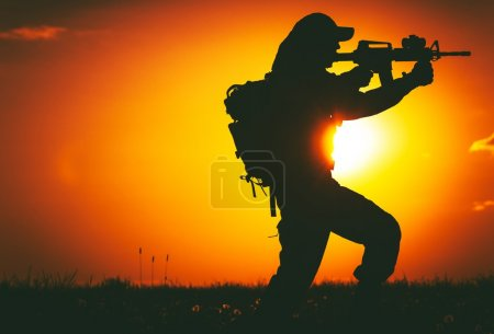 Photo for Army Trooper with Assault Rifle in Mission. Military Mission at Sunset. Military Concept. - Royalty Free Image