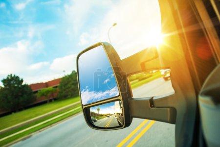 Photo for Cargo Van Driving Concept. Large Cargo Van Mirror. Van in Motion. - Royalty Free Image