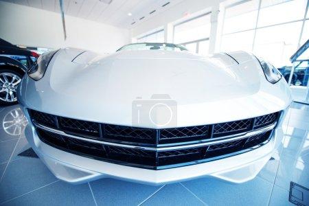 Photo pour Modern Super Car in Dealer Showroom. Car Sales Industry - image libre de droit