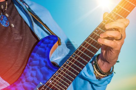 Photo for Rock Guitar Player. Men Playing Electric Guitar Closeup Photo. - Royalty Free Image