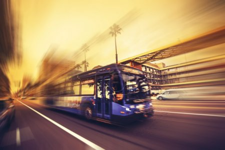 Photo for Public Transportation. Speeding Bus in Santa Monica, California, United States. Conceptual Photography. - Royalty Free Image