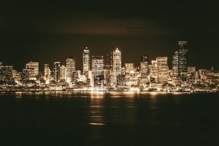 Photo for Golden Seattle Skyline at Night. Seattle and the Puget Sound in Golden Brown Elegant Color Grading. - Royalty Free Image