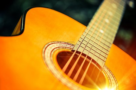 Photo for Acoustic Wooden Guitar Closeup Photo. Guitar Playing Concept. - Royalty Free Image