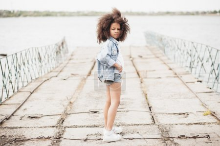 Photo for Outdoor portrait of a beautiful stylish little girl - Royalty Free Image