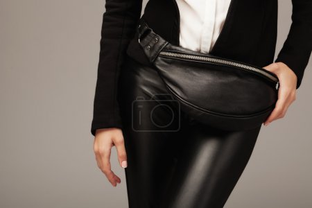 Photo for Elegant woman with a black leather fanny pack - Royalty Free Image