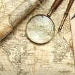 Vintage map with retro objects and magnifier...