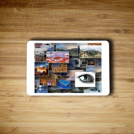 Photo for Tablet lying on the table with photos on the screen - Royalty Free Image
