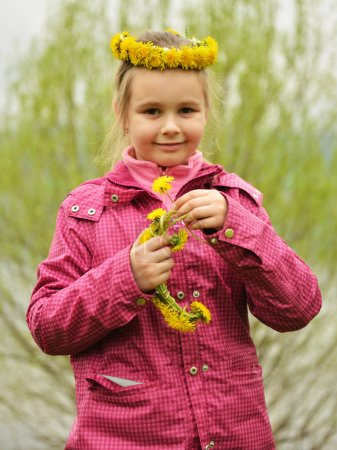 Young girl with dandelion chaplet
