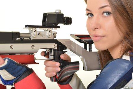 Woman training sport shooting with air rifle gun