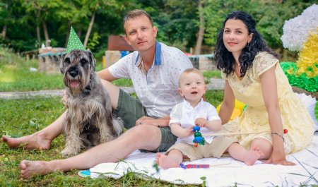 Young couple with a dog in fancy dress