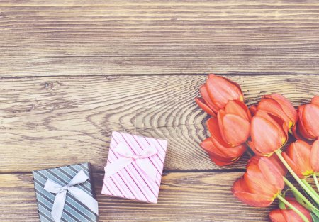 Tulips on Wooden Table with Little Gift Boxes