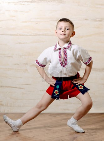 Little boy practicing a ballet pose