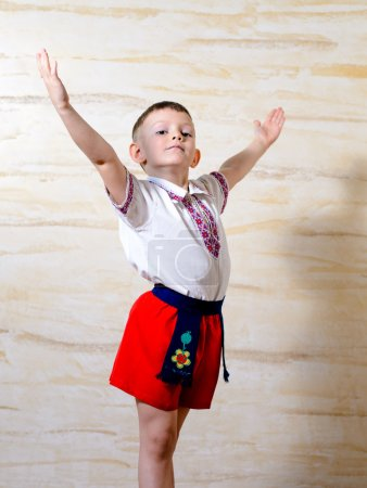 Ukrainian talented boy posing with raised arms