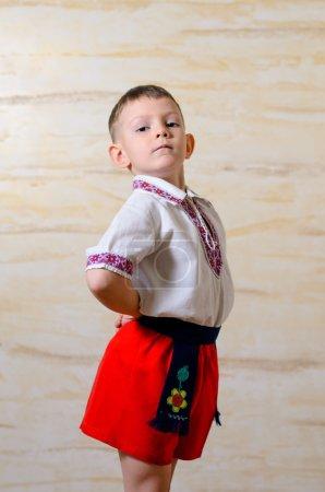 Ukrainian talented boy posing with raised arms